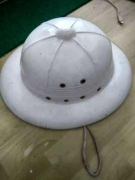 Helm atau topi sepeda onthel