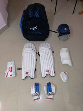 Full cricket kit with bag. No bat included.
