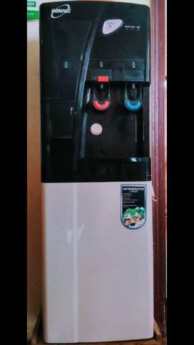 HOMAGE WATER DISPENSER with refrigerator cabinet and a glass stanor.