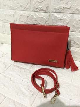 Clutch / tas selempang merk jims honey red