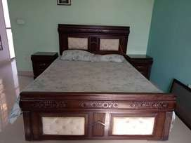 Queen size bed with side tables and mattress