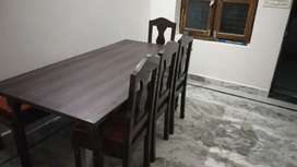 One week old 6 seater dining table of pure sagwan wood