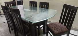 6 seater Dinning table in pure teak with heavy glass top