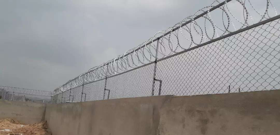 Boundry wall  Chain Linked Fence and Razor wire