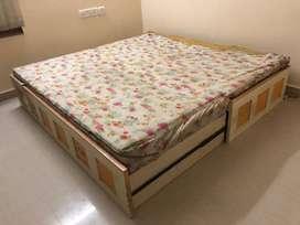 Solid teakwood queen size storage bed.