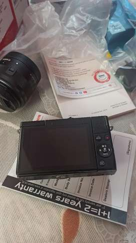 BRAND NEW CANON M200 WITH 15-45
