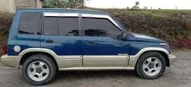 Escudo nomade 1998