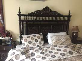 Wooden bed without matress beautifully carved