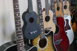 Ukuleles and guitars branded at Acoustica