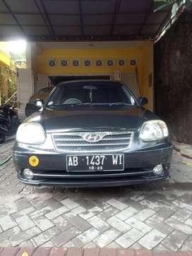 Hyundai Avega GL Hitam Metalik Manual 2008 tgn 1 dari baru