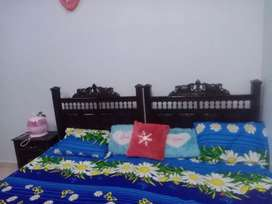 2 single wooden bed