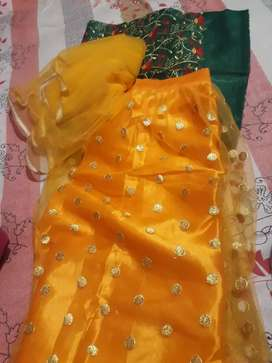 Yellow lehenga with green blause