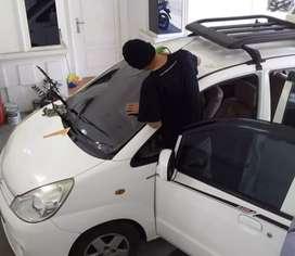 Ahlinya pasang kaca film mobil
