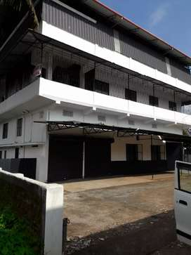 Commercial building with parking area for rent.