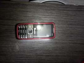 Red and black coloured Keypad phone