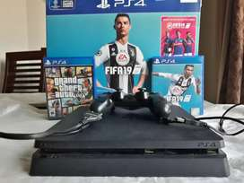 Playstation 4 slim 500 gb 1 controller and 3 games.Fifa 19 and GTA 5