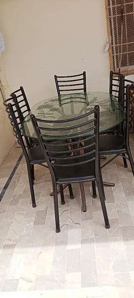 Oval glass dinning table with 6 chairs