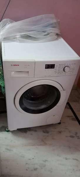 Bosch washing machine 6.5 kg in warranty with stand in