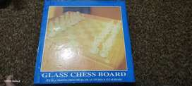 Glass chess board. Table decoration. Glass made chess game.