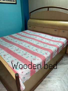 Wooden bed with two storage boxes