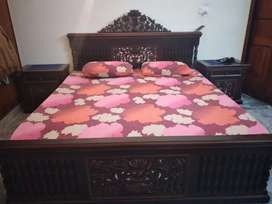 Bed with 2 side tables and dressing table.