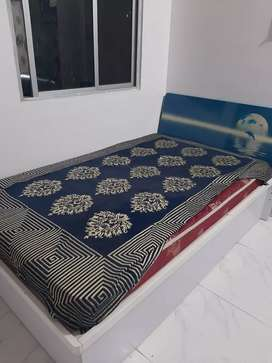 Very attractive single bed with cushions