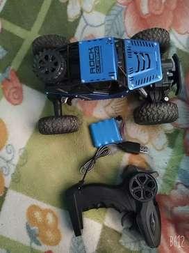 A 4 motor rock climbing racing remote car .