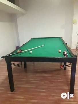 Pool table with 9 balls and stick. green colour