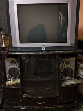 LG tv with a wooden stand