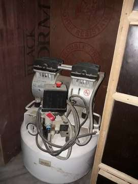 Dental chair and compressor