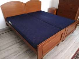 King sized wooden bed