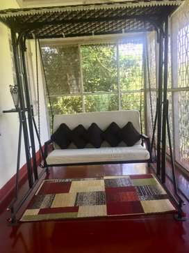 Iron swing with soft roof