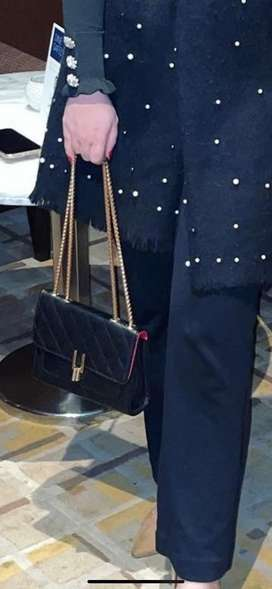 Sling bag, black colour with golden chain