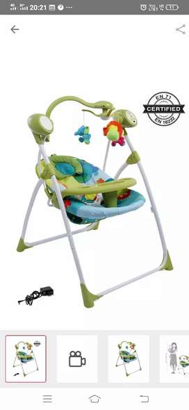 Babyhug electric swing  (almost new) at half price