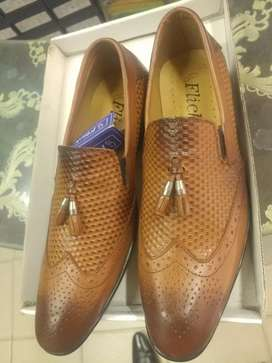 Imported lather shoes at fair price.