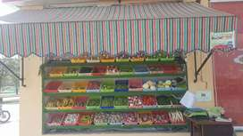 A beautiful vege and fruit rack with tarpaal