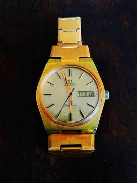 Vintage Omega Geneve automatic wrist watch w/ day, date & gold finish