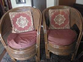 4 cane chairs with 2 side tables and 1 centre table