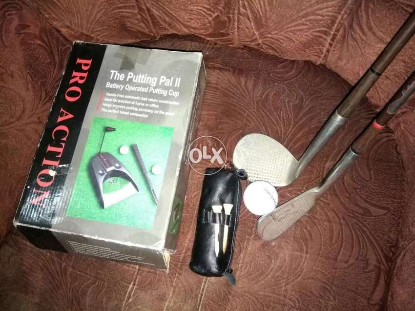 Golf Sticks Bools stand and Automatic putting pal. 0