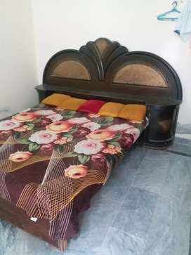 Double bed with mattress and side table