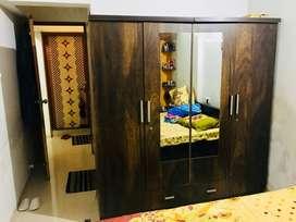 4 door wooden cupboard .. just one year old