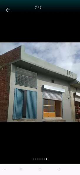 4 Marla house with shop for urgent sale.
