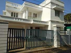 5.7 cent 1850 sft 4 bhk new build house at paravur town near peruvaram