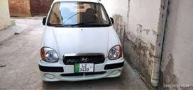 It's a Hyundai santro 2004 model and Lahore registered.new seat covers