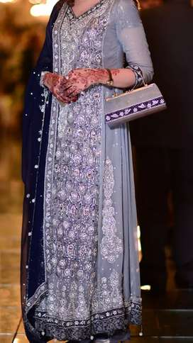Bridal suit for walima bride with clutch