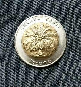 Uang koin 1000 kelapa sawit kuning putih