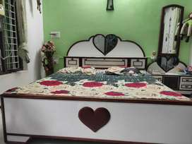 Bed with mattress and dressing table available in very good condition