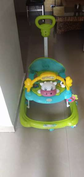 Baby Hug baby walker in 1000 rs with parent push handle and height adj
