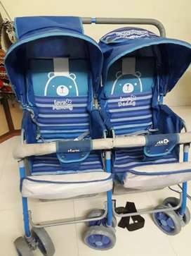 Twin pram is for sale
