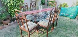 Dinning table 6 chairs, glass top. Solid wood. Good conditions